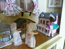 Little Sylvia and Polly Pronto have taken Shirley upstairs to see Isla's collection of Dolls' Houses.