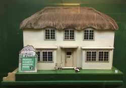 "[Wrongly] Labelled ""'Y Bwythn Bach', The Little House, is made by Triang, British, 1930s""."