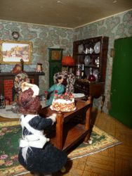 """""""Modom's cake is ready."""" says Sally wheeling in a trolley with a beautiful gateaux on it."""