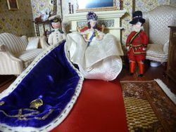 The Queen and her personal guard were assembled in the hotel drawing room.