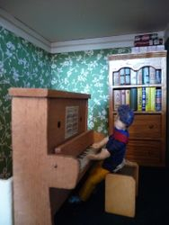 Upstairs, Alan's friend, Dudley, was at the piano again and he wasn't half bad.