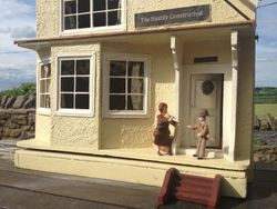 Bernard and Rita meet at a hastily constructed country pub near Greconville.