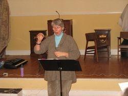 Ellen Oak working with alto section