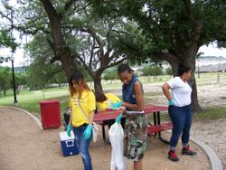 Key Club members doing park cleanup