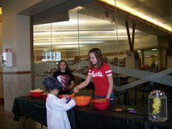 Serving snacks at Halloween Book Bash
