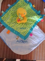 Tactile toy and Swaddler