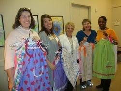 Sewer and Volunteers Deliver Dresses-November 17, 2010