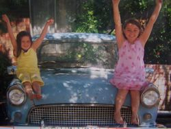 olivia and claudia our grandaughters sitting on our old consul ute