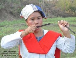 Playing Kingkrong-Traditinal Musical Instrument