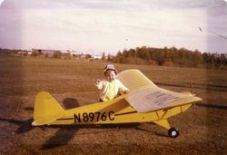 My wifes son next to his grandfathers piper cub. 1977