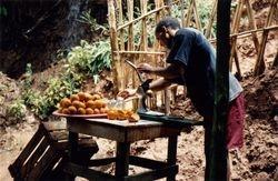 Man Squeezing Fresh Orange Juice at Casacades D'Ouzoud Waterfalls