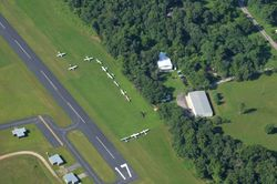 EAA 1218 and Runway 17 by Henny