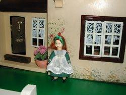 A sad little girl stands outside Tudor Hall...