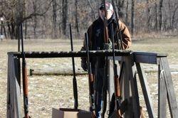 Rack of shotguns awaiting their turn