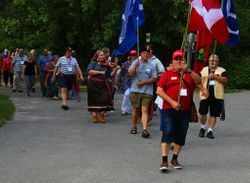 MNO Veterans march the colours at the 2018 AGA in Peterborough canoe arrival.