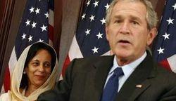 U.S. President Bush speaks alongside Hunaina Sultan Ahmed Al Mugheri in Washington