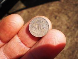1851 Three Cent Piece On My Fingertip