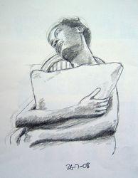 girl sitting holding a cushion