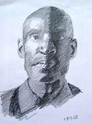man's face half in shadows