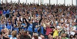 Pompey Fans arms aloft