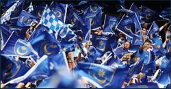 Pompey Fans wave the flags