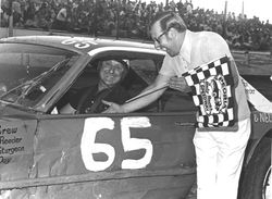 Johnny Coonce #7 Ford Fairlane with Flagman Lloyd Ewing at Peoria Speedway