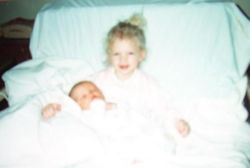 Taylor with her new baby brother #3