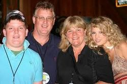 Taylor with her parents and brother