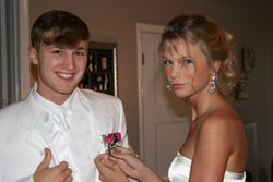 Taylor pinning a flower on her date