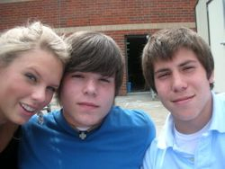 Taylor with two guys