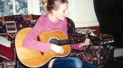 Taylor playing guitar