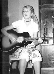 Taylor performing at school