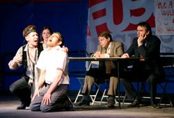 Leigh Acton as Brian (left kneeling), Carrie Marx as Priscilla (background), James Pellow as David and Pete Picton as Jim in In Transit