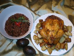 Sutffed baked chicken with congri rice & baked potato in garlic sauce