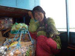Shy salesgirl. Myitkyina-Bhamo boat.
