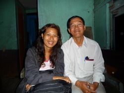 Ahyin (r), my guide for the Indawgyi/Sinbo leg. Here working his charms on a student on the Hopin-Myitkyina train.