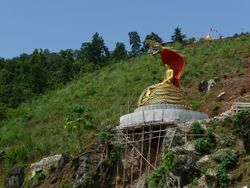 The Buddah shelters from the sun beneath the hood of a cobra. Indawgyi lake.