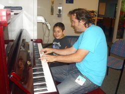 "Mateo Messina and I composing ""I am""."