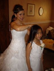 Vy, the bride, fixing her flower girl's hair