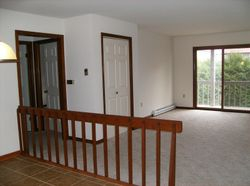 View of hallway, dining room, living room