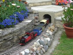 A visiting mixed train emerging from 'Patio Tunnel'