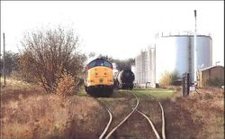 Class 37 waits in the sidings at Charringtons Oil Terminal