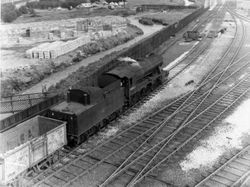"""90069 Freight at Brescot """"up"""" reception. 1968"""