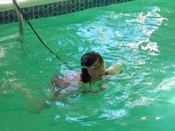 Swim breaststroke on the swim tether.