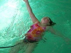 Backstroke on the swim tether.