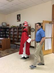 Father ?Cat in the Hat? Daniel greets parishioners  after Mass & before the Book Giveaway May 20, 2018