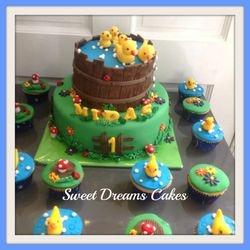 eendjes taart en cupcakes