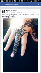 Henna incorperated around the skull tattoo