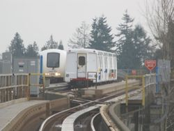 A Mark II SkyTrain comes up on a Mark I
