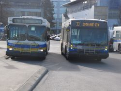 1995 D40LF R7123 and 2007 NovaBus LFS V9701 at UBC Loop